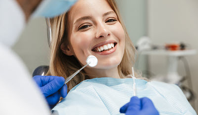 young woman getting a dental checkup