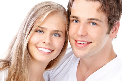 Happy smiling couple over white background
