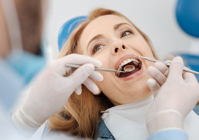 woman getting a dental inspection