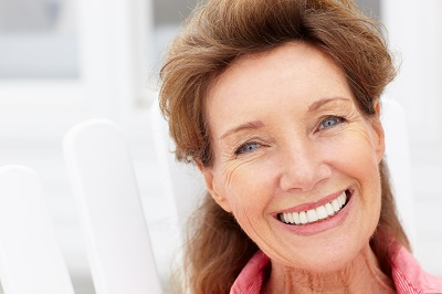Senior woman smiling at home