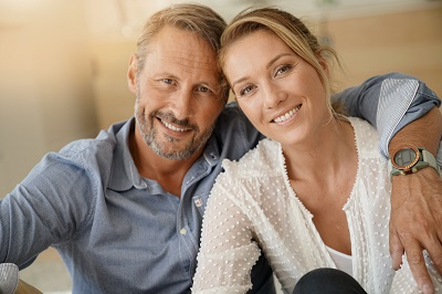mature couple relaxing and smiling