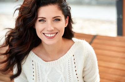 Image of smiling woman outdoors