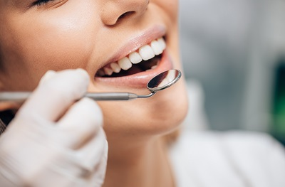 Image of woman getting a dental exam