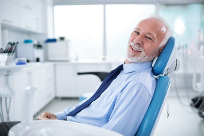 senior man awaiting treatment in dental chair