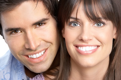 close up of smiling couple with white smiles