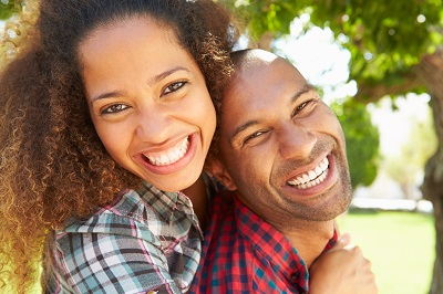 african american couple smiling at the park