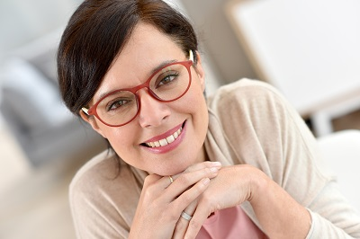 beautiful woman with glasses smiling at home