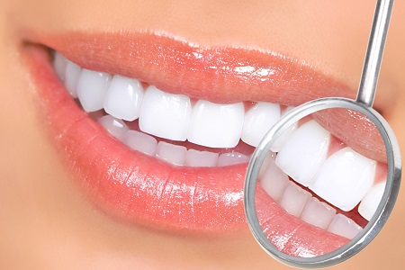 Smiling Teeth with smile and dental tool