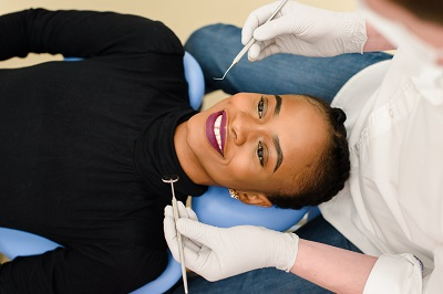 young african american woman getting dental treatment