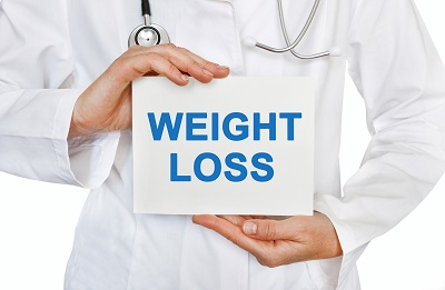 Weight Loss card in hands of Medical Doctor