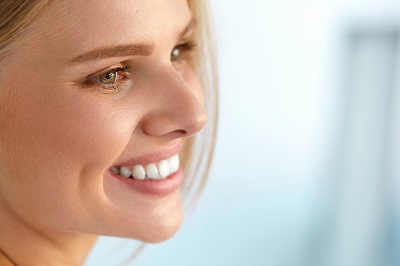 Smiling blonde woman with perfect white smile