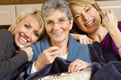 family of three various age women smiling together