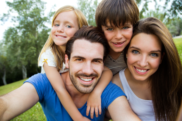 Smiling Family Outdoors-Isaac Menasha, DDS