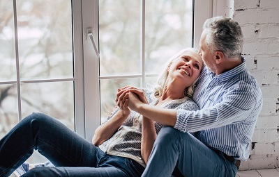 senior couple relaxing at home by the window