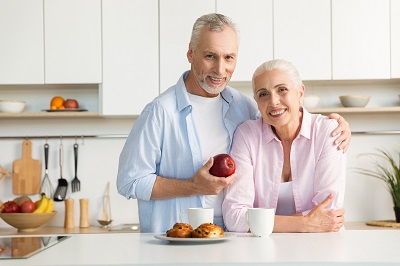 mature couple in the kitchen at home