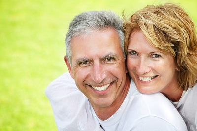 Close-up portrait of a mature couple smiling and embracing