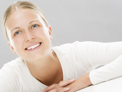 blonde woman smiling in white background