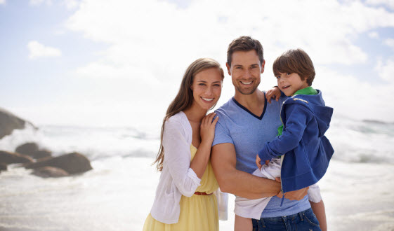 photo of smiling family at the beach