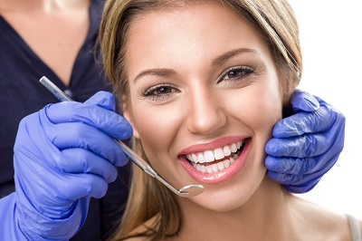 woman getting a dental cleaning in dental office