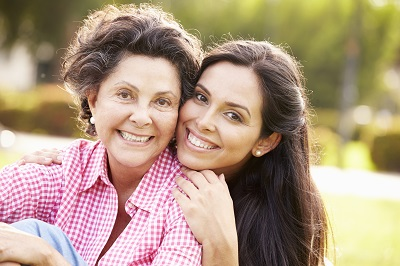 Image of senior mother and adult daughter outdoors
