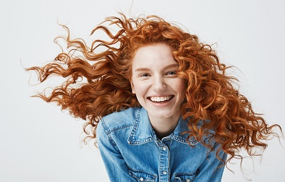 Image of young red haired girl smiling