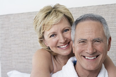 senior couple with white teeth at home