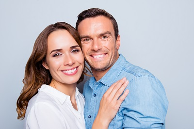 Close up of couple over grey background