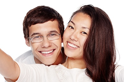 Close up portrait of young interracial couple