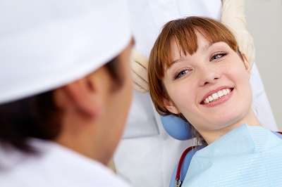 Image of smiling patient at dental chair