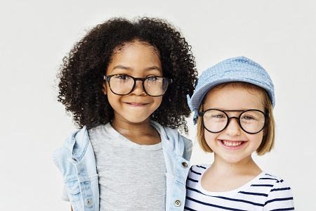 2 little girls wearing glasses over white background
