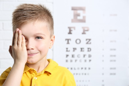 Little boy having eye test
