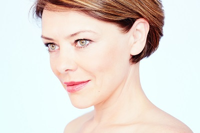 Close up portrait of beautiful middle aged woman with short brown hair
