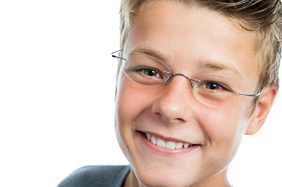 Extreme close up portrait of teen boy wearing glasses.isolated on white background