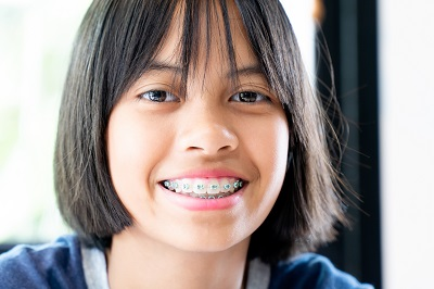 Girl with dental braces smiling