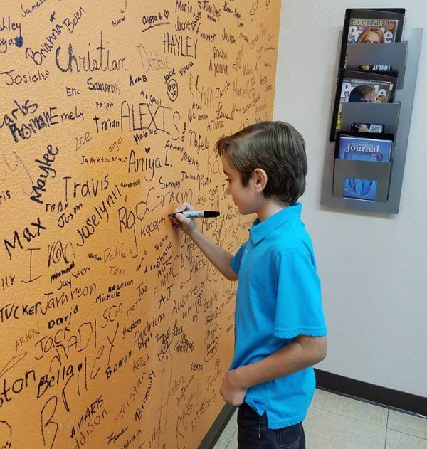 Little ones autographing the wall at Alligator Dental a pediatric dentist located in Sequin, Texas.  Accepting new patients now!