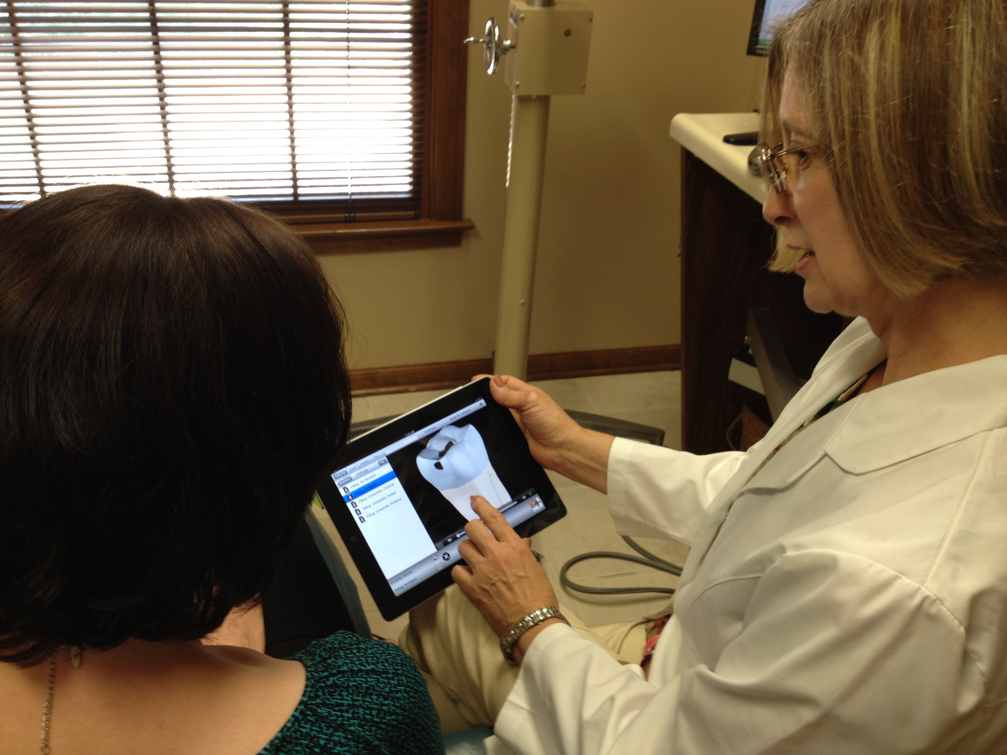 Dr. Gates reviews treatment options with a patient