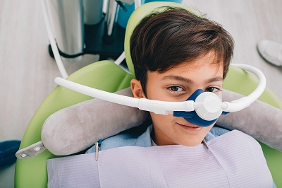 little boy getting nitrous oxide sedation at dental clinic