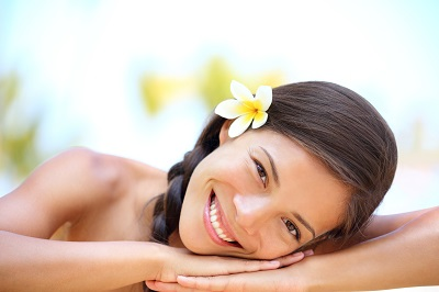 Beautiful smiling girl outdoor portrait at massage spa