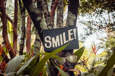 Smile sign on tree in hawaiian forest