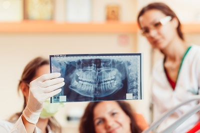patient looking at x-ray in dental office