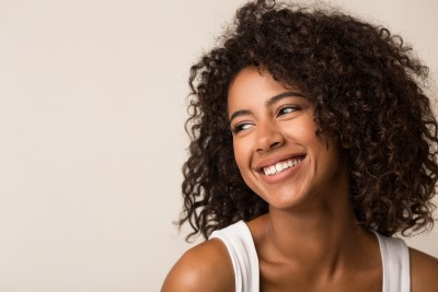 A young woman shows of her smiles after a visit to Callahan & Klein Dental