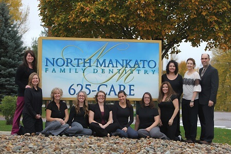 North Mankato Family Dentistry group photo in front of sign