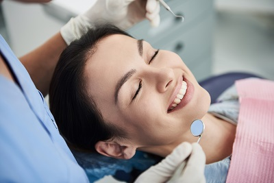 relaxed female patient about to get treatment at dental office