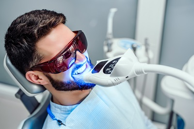 young man getting in-office teeth whitening