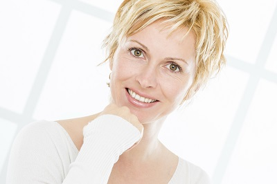 middled aged blonde woman with short hair smiling