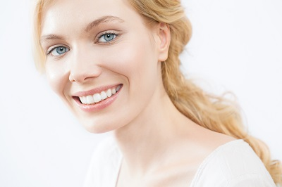 blonde woman with beautiful white smile
