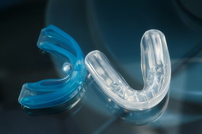 dental trainer alignment appliance on glass background, closeup