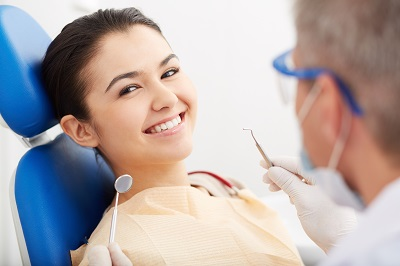 smiling patient looking at camera at the dentist
